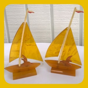 bakelite boats with carved bakelite birds and celluloid masts